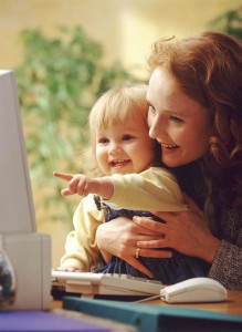 Mom and child having fun on the computer